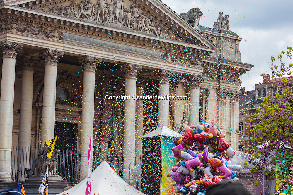 confetti in the air at a gay pride parade in Brussels in front of de Beurs.