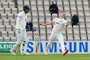Sam Cook of Essex runs past James Vince of Hampshire to bowl during the first day of the Specsavers County Champ Div 1 match between Hampshire County Cricket Club and Essex County Cricket Club at the Ageas Bowl, Southampton, United Kingdom on 5 April 2019.