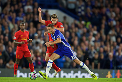 LONDON, ENGLAND - Friday, September 16, 2016: Liverpool's Adam Lallana in action against Chelsea's Nemanja Matic during the FA Premier League match at Stamford Bridge. (Pic by David Rawcliffe/Propaganda)