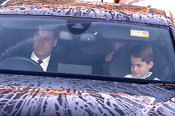 Prince George sits in the front passenger seat next to his father the Duke of Cambridge as they arrive for the Queen's Christmas lunch at Buckingham Palace, London.