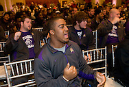 ECU football player Robert Jones, center, does a team cheer during a welcome reception on Dec. 24th for East Carolina University football team  at the Mayflower Hotel in Washington, DC, where they will be staying for the Military Bowl. They will face the University of Maryland in the Military Bowl on December 29, 2010. (Photo by Alan Lessig)