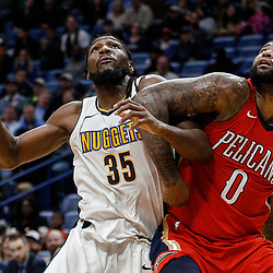 Dec 6, 2017; New Orleans, LA, USA; Denver Nuggets forward Kenneth Faried (35) and New Orleans Pelicans center DeMarcus Cousins (0) battle for a rebound during the second quarter at the Smoothie King Center. Mandatory Credit: Derick E. Hingle-USA TODAY Sports