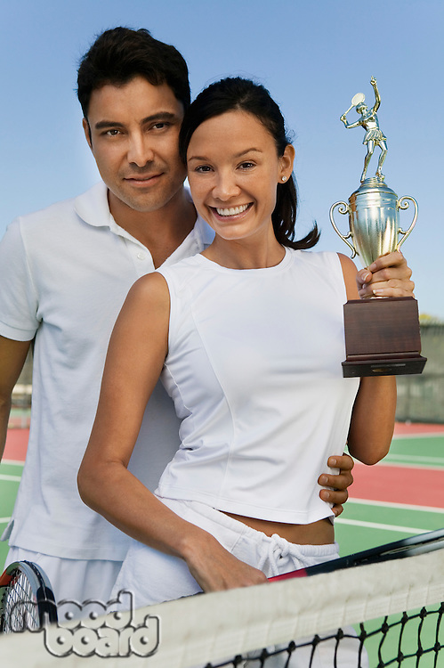 Tennis Players Holding Trophy
