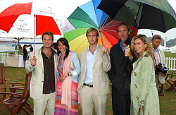 Left to right, , TOM RUTHERFORD, NAOMI FRANKS, HARRY RUTHERFORD and ANGIE & MIKE RUTHERFORD at the 2005 Cartier International Polo between England & Australia held at Guards Polo Club, Smith's Lawn, Windsor Great Park, Berkshire on 24th July 2005.<br />