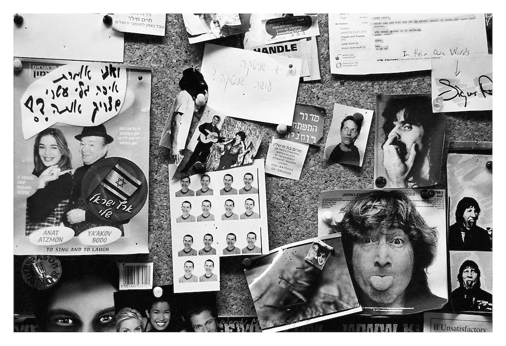 Notes and pictures on a board in an Israeli music store in the center of Jerusalem. Israel, 2006