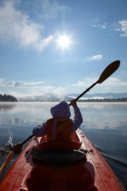 """Boy Kayaking on Prosser Reservoir 1"" - This photograph of a boy kayaking was photographed on Prosser Reservoir in Truckee, CA."
