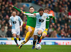Bradley Dack of Blackburn Rovers (C) is tackled by Alan Browne (L) and Ryan Ledson of Preston North End - Mandatory by-line: Jack Phillips/JMP - 09/03/2019 - FOOTBALL - Ewood Park - Blackburn, England - Blackburn Rovers v Preston North End - English Football League Championship