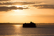 Sunset over Martello Tower fortress in the River Solent on South Coast of England near Portsmouth, United Kingdom