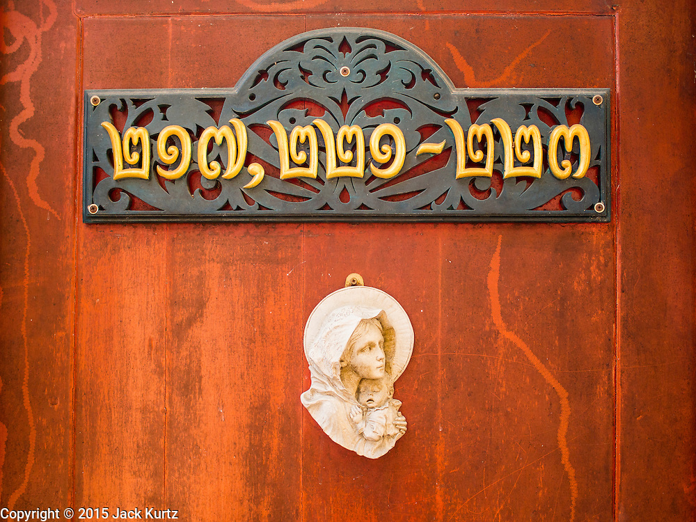 06 FEBRUARY 2015 - BANGKOK, THAILAND: The doorway to a Catholic home in the Thonburi section of Bangkok near the Santa Cruz Church. Now the neighborhood around the church is known for the Thai adaptation of Portuguese cakes baked in the neighborhood. Several hundred Siamese (Thai) Buddhists converted to Catholicism in the 1770s. Some of the families started baking the cakes. When the Siamese Empire in Ayutthaya was sacked by the Burmese, the Portuguese and Thai Catholics fled to Thonburi, in what is now Bangkok. The Portuguese established a Catholic church near the new Siamese capital. There are still a large number of Thai Catholics living in the neighborhood around the church.       PHOTO BY JACK KURTZ