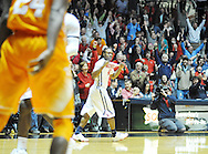 "Mississippi Rebels guard Stefan Moody (42) pops his jersey after making a three pointer against Tennessee at the C.M. ""Tad"" Smith Coliseum in Oxford, Miss. on Saturday, February 21, 2015. Mississippi won 59-57. (AP Photo/Oxford Eagle, Bruce Newman)"