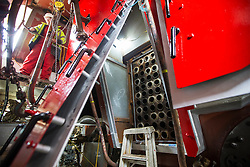 "© Licensed to London News Pictures. 04/05/2016. Birkenhead UK. Picture shows the inside of the Steam engine on the Daniel Adamson during restoration at Camel Laird docks. The Daniel Adamson steam boat has been bought back to operational service after a £5M restoration. The coal fired steam tug is the last surviving steam powered tug built on the Mersey and is believed to be the oldest operational Mersey built ship in the world. The ""Danny"" (originally named the Ralph Brocklebank) was built at Camel Laird ship yard in Birkenhead & launched in 1903. She worked the canal's & carried passengers across the Mersey & during WW1 had a stint working for the Royal Navy in Liverpool. The ""Danny"" was refitted in the 30's in an art deco style. Withdrawn from service in 1984 by 2014 she was due for scrapping until Mersey tug skipper Dan Cross bought her for £1 and the campaign to save her was underway. Photo credit: Andrew McCaren/LNP ** More information available here http://tinyurl.com/jsucxaq **"