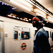 Hip passenger waits for London metro train in Earl's Court. .Picture taken 2005 by Justin Jin