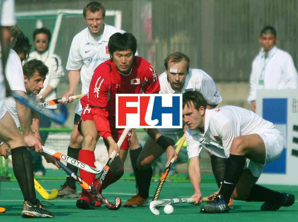 Kakamigahara, Gifu-Japan : Katayama Kenichi of Japan facing a tough Polish defence in the Olympic Hockey Qualifier at Gifu Perfectural Green Stadium at Kakamigahara on 06 April 2008. Japan beat Poland 6-1.<br /> Photo: GNN/ Vino John