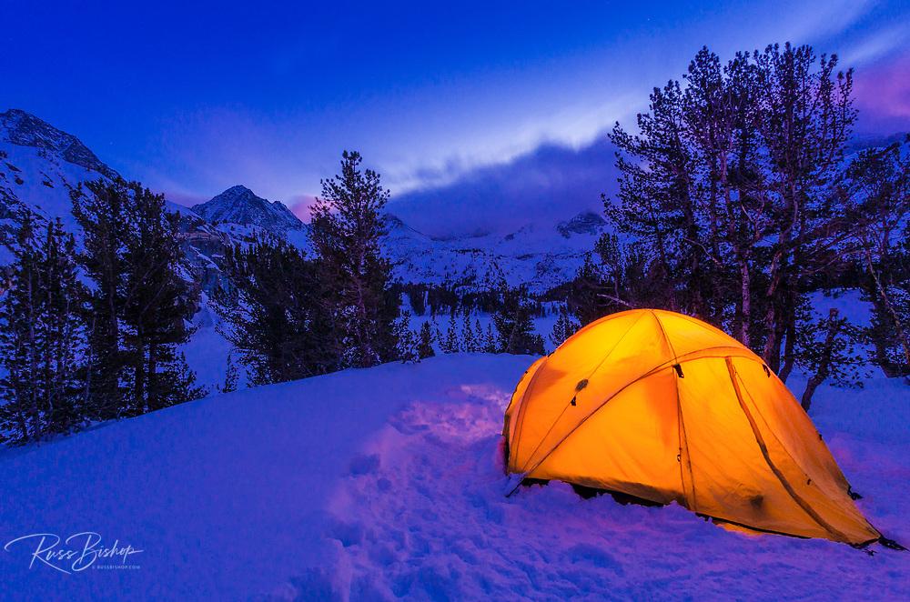 Winter camp at dusk, John Muir Wilderness, Sierra Nevada Mountains, California USA