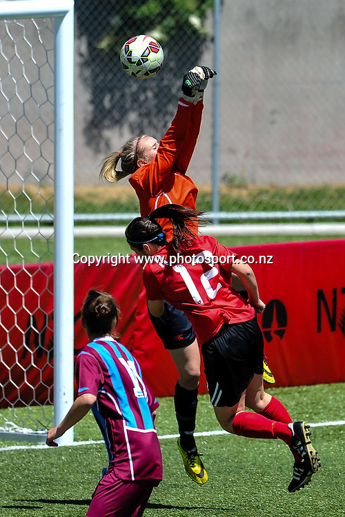 Tessa Nical of the Football South saves a goal under pressure from Lauren Dabner of the Mainland Pride in the ASB Womens League match, Mainland Pride v Football South, 23 November 2014. Photo:John Davidson/www.photosport.co.nz
