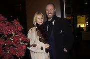Mr. and Mrs. Simon and Emma Oakes. Boucheron opening. 164 New Bond St. 5 December 2002. © Copyright Photograph by Dafydd Jones 66 Stockwell Park Rd. London SW9 0DA Tel 020 7733 0108 www.dafjones.com
