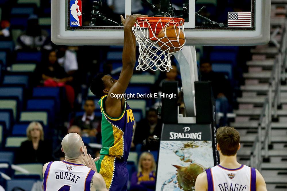 Feb 6, 2013; New Orleans, LA, USA; New Orleans Hornets small forward Al-Farouq Aminu (0) dunks over Phoenix Suns center Marcin Gortat (4) during the second half of a game at the New Orleans Arena. The Hornets defeated the Suns 93-84. Mandatory Credit: Derick E. Hingle-USA TODAY Sports