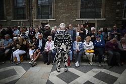 © Licensed to London News Pictures. 27/09/2015. London, UK. The Pearly King of Mile End talks to the crowd in Guildhall Square during a Harvest Festival celebration. Photo credit: Peter Macdiarmid/LNP