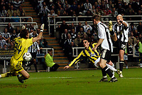 Photo: Jed Wee.<br /> Newcastle United v Fenerbahce. UEFA Cup. 19/10/2006.<br /> <br /> Newcastle's Antoine Sibierski (R) fires the ball past Fenerbahce goalkeeper Rustu Recber for the opening goal.
