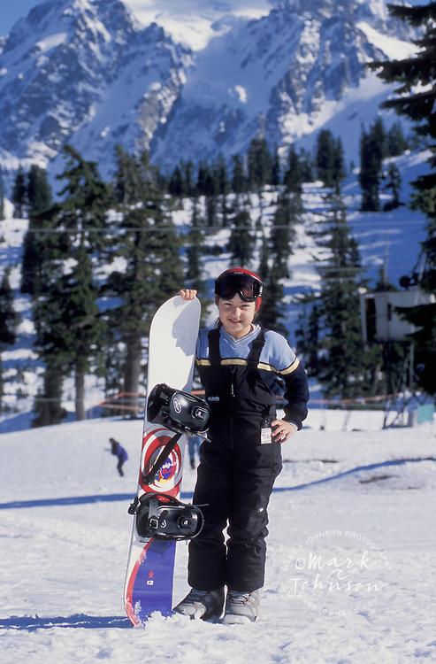 Young girl posing with snowboard, Mt. Baker, Cascade Range, Washington
