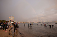 Rainbow over the swim start. Urban Geelong 2.80.20 Triathlon. 2012 Geelong Multi Sport Festival. Eastern Beach, Geelong, Victoria, Australia. 12/02/2012. Photo By Lucas Wroe