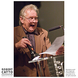 Three decades of NZ feature filmmaking were celebrated at the Film Archive on 6 October 2007 with a special gala screening of Sleeping Dogs, Roger Donaldson's 1977 debut feature film..Sleeping Dogs was the first NZ feature to be released in the United States, was highly successful in the Soviet Union and is credited with being the leading driver for the establishment of the New Zealand Film Commission.. Seen here is actor Ian Mune, reading from a letter from director Roger Donaldson prior to the film being screened.