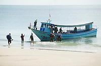 Ferry boat picking up tourists on a beach Ko (Koh) Phangnan (Phangan) Gulf of Thailand Thailand&#xA;<br />