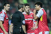 The Rotherham United players talk to Stuart Attwell (referee) to find out why Peter Odemwingie (Rotherham United) received a straight red card during the EFL Sky Bet Championship match between Rotherham United and Leeds United at the New York Stadium, Rotherham, England on 26 November 2016. Photo by Mark P Doherty.