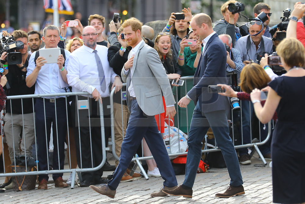 © Licensed to London News Pictures. 18/05/2018. London, UK. Prince Harry and Prince William greet Royal fans outside Windsor Castle on the eve of the Royal Weeding. Prince Harry and Meghan Markle are to be married in Windsor tomorrow, Saturday 19 May 2018. Photo credit: Rob Pinney/LNP