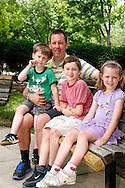 (from left) Eli, 4; Christian Taylor of Dayton; Bryce, 8 and Lauren, 5 at Shafor Park in Oakwood, Sunday, June 9, 2013.