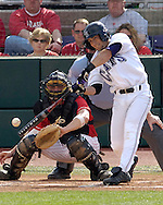Kansas State's Tyler Link (R) makes contact against Nebraska's Tony Watson.  Nebraska held on to be Kansas State 5-4 at Tointon Stadium in Manhattan, Kansas, April 1, 2006.