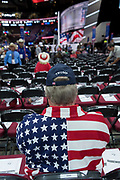A Trump supporter wearing an American flag shirt waits for the start of the Republican National Convention July 20, 2016 in Cleveland, Ohio.