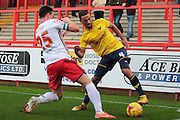 Oxford United midfielder Kemar Roofe and Stevenage FC defender Ronnie Henry during the Sky Bet League 2 match between Stevenage and Oxford United at the Lamex Stadium, Stevenage, England on 31 October 2015. Photo by Jemma Phillips.
