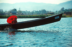 BURMA SHAN STATE INLE LAKE MAR95 - A buddhist monk sits in a speedboat as he travels from his monastery to town. About 10 monks live in a secluded monastery built on stilts in the middle of the Inle Lake... jre/Photo by Jiri Rezac. . © Jiri Rezac 1995. . Contact: +44 (0) 7050 110 417. Mobile: +44 (0) 7801 337 683. Office: +44 (0) 20 8968 9635. . Email: jiri@jirirezac.com. Web: www.jirirezac.com