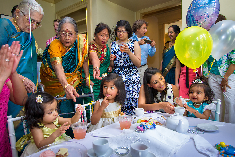 Houston, Texas: Hema Ramaswamy (center) attends the celebration of her niece Rukmini's (far right) first birthday--a princess-themed tea party with four generations of family from Texas, New Jersey, and Chennai, India, on May 24, 2014.