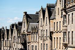 Row of old tenement buildings on Cockburn Street in Old Town of Edinburgh, Scotland, UK