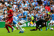 Manchester City midfielder Raheem Sterling (7) heading towards goal is stopped by Liverpool goalkeeper Alisson Becker (13) during the FA Community Shield match between Manchester City and Liverpool at Wembley Stadium, London, England on 4 August 2019.