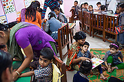Sitting next to her mother Jtoyi Yadav, 34, (left) Rachi, 7, a disabled girl affected by microcephaly and myoclonic epilepsy, is receiving basic schooling while sitting on the floor of 'Chingari Trust Rehabilitation Centre', one of two vital medical institutions funded by 'The Bhopal Medical Appeal' in Bhopal, Madhya Pradesh, central India.