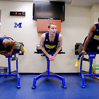 ANN ARBOR, MICHIGAN -- February 5, 2013 -- University of Michigan's Trey Burke, left to right, Nik Stauskas, and Tim Hardaway Jr. work on their core in the gym as they prepare for rival Ohio State University in Ann Arbor, Michigan.  The Wolverines won 76-74 in overtime.   (PHOTO / CHIP LITHERLAND)