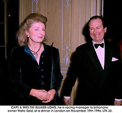 CAPT. & MRS TIM BULWER-LONG, he is racing manager to billionaire owner Wafic Said, at a dinner in London on November 19th 1996.LTN 33.