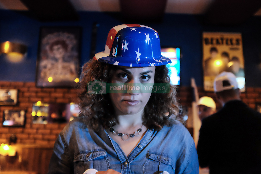 November 9, 2016 - Jerusalem, Israel - Israeli Americans watch and react to the unfolding drama of the 2016 US Elections throughout the night on TV screens covering major networks at Mike's Place, a popular bar in Jerusalem. (Credit Image: © Nir Alon via ZUMA Wire)