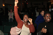 November 6, 2012- Harlem, NY:  Audience at the U.S. Presidential Election Watch Party held at the Schomburg Center for Research in Black Culture on November 6, 2012 in Harlem, New York City. The Schomburg Center for Research in Black Culture, a research unit of The New York Public Library, is generally recognized as one of the leading institutions of its kind in the world. For over 80 years the Center has collected, preserved, and provided access to materials documenting black life, and promoted the study and interpretation of the history and culture of peoples of African descent. (Terrence Jennings)