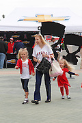 ANAHEIM, CA - MAY 08:  A mother and her two young daughters work their way to the main entrance for the Mother's Day game between the Cleveland Indians and the Los Angeles Angels of Anaheim on Sunday, May 8, 2011 at Angel Stadium in Anaheim, California. The Angels won the game 6-5. (Photo by Paul Spinelli/MLB Photos via Getty Images)