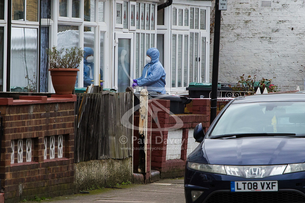 A forensics investigator at a home adjacent to the scene in Chalgrove Road, Tottenham, North London, where a seventeen year-old girl was shot dead on the evening of April 2nd. London, April 03 2018.