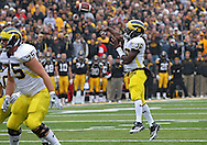 November 05, 2011: Michigan Wolverines quarterback Denard Robinson (16) throws a 5 yard touchdown pass during the first quarter of the NCAA football game between the Michigan Wolverines and the Iowa Hawkeyes at Kinnick Stadium in Iowa City, Iowa on Saturday, November 5, 2011. Iowa defeated Michigan 24-16.