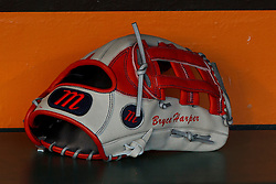 SAN FRANCISCO, CA - MAY 21: Detailed view of a baseball glove belonging to Bryce Harper (not pictured) of the Washington Nationals in the dugout before the game against the San Francisco Giants at AT&T Park on May 21, 2013 in San Francisco, California. The San Francisco Giants defeated the Washington Nationals 4-2 in 10 innings. (Photo by Jason O. Watson/Getty Images) *** Local Caption ***