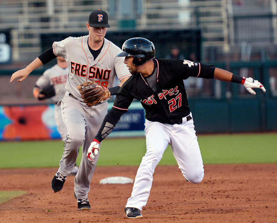 gbs061317m/SPORTS -- The Isotopes' Noel Cuevas, 27, gets caught in a run down between first and second by Fresno's shortstop Reid Brignac in the third inning of the game in Isotopes Park on Tuesday, June 13, 2017. (Greg Sorber/Albuquerque Journal)