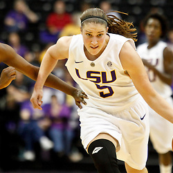 November 16, 2011; Baton Rouge, LA; LSU Tigers guard Jeanne Kenney (5) drives past Georgetown Hoyas guard Morgan Williams (15) during the first half of a game at the Pete Maravich Assembly Center.  Mandatory Credit: Derick E. Hingle-US PRESSWIRE