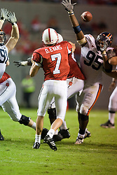 Virginia defensive end Jeffrey Fitzgerald (95) pass rushes North Carolina State quarterback Daniel Evans (7).  The North Carolina State Wolfpack defeated the #15 Virginia Cavaliers 29-24 at Carter Finley Stadium in Raleigh, NC on October 27, 2007.