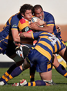Waikato's Callum Bruce caught by BOP players during the Air New Zealand Cup rugby match between Waikato and Bay of Plenty at Bay Park Stadium, Tauranga, New Zealand, Saturday 22 August 2009. Photo: Stephen Barker/PHOTOSPORT